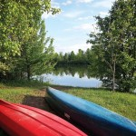 Canoes by the lake at Gaie Lea